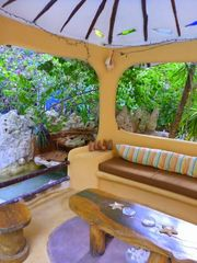 Poolside gazebo is the perfect spot for socializing or siesta-ing. - Playa del Carmen villa vacation rental photo