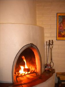 Enjoy a roaring fire in the traditional kiva fireplace