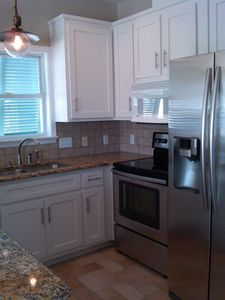 Upgraded kitchen. New stainless steel refrigerator and range, cabinets.