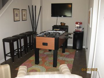 Rec Room with chairs and foosball