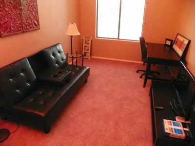 Den/Office with Futon and office work area. Wi Fi. Flat screen.