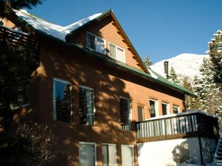 Taos house photo - Winter afternoon with El Salto peak shimmering in the background