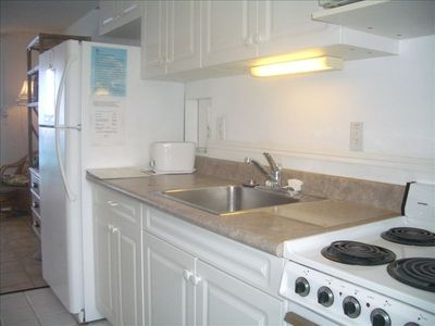 A full galley style kitchen with everything you need for your vacation.