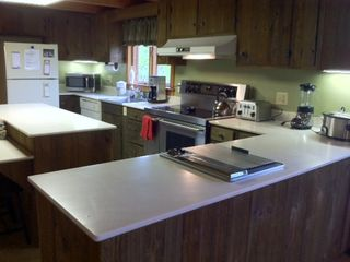 Large kitchen stocked with every you need to cook for your family.