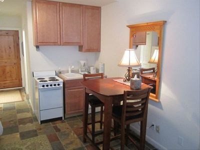 Functional kitchen with stove, oven, sink & dishwasher. Fridge & micro to left.