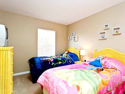 3rd bedroom with Toy Story and Princesses themed beds; small TV and DVD player
