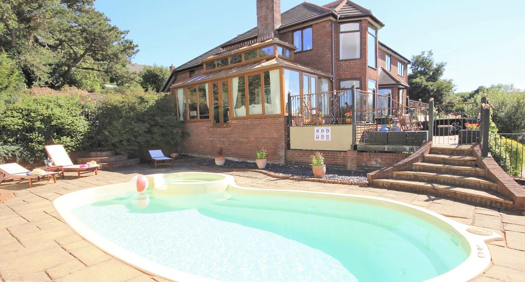 Large family home with outdoor heated homeaway colwyn bay for Heated garden swimming pools
