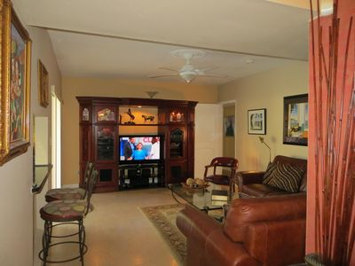 Family room offers a great place to watch your favorite TV programs in comfort.