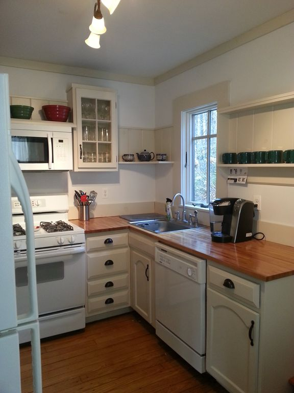 The kitchen has all the amenities including a Keurig coffeemaker and dishwasher