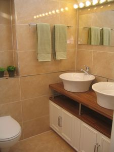 En-suite shower room with large shower and double