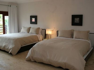 2 Similar Double bedrooms each with two double beds.