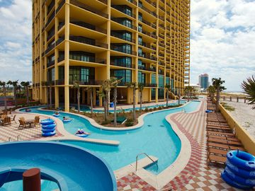 Orange Beach condo rental - Top of Slide looking onto Lazy River Beach side. Lots of seating, tables etc.