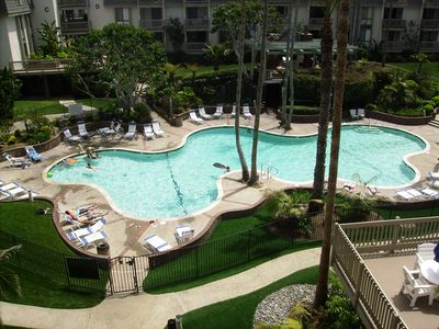 View of the pool from Condo balcony, 1st floor bedroom, and Penthouse patio.