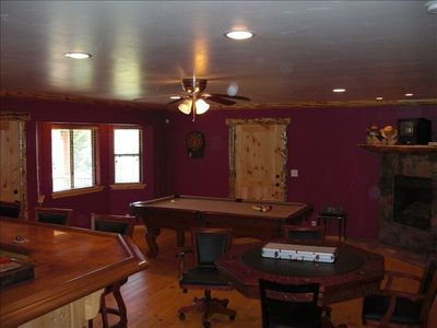 Gameroom w/ TV, pool table, poker table, bar w/ frig & microwave & dart board
