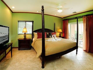"Playa Herradura condo photo - King-size bed in the master bedroom, 36"" TV and private balcony"