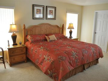 Tastefully furnished master bedroom with king size bed and bedroom set