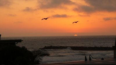 We call this Pelican Sunset - Surfers and Pelicans wait for the sun to go down