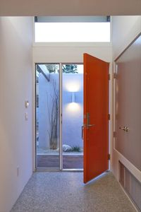 Entry with exposed concrete floors throughout