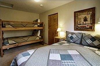 Upstairs bedroom with comfy queen bed and twin bunkbed.