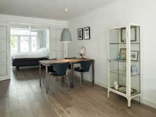 South Amsterdam apartment photo - { Dining space with view to bedroom, separated by glass doors & curtains }