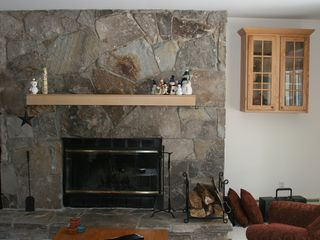 West Dover condo photo - cuddle up by the wood burning fireplace. Plenty of firewood available.