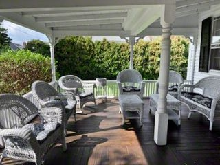 Edgartown house photo - Covered Porch Anchors Outdoor Entertaining & Relaxing