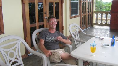 Enjoying the porch with a Belizean coctail