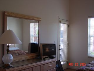 Port St. Lucie condo photo - TV set in Master with door to balcony