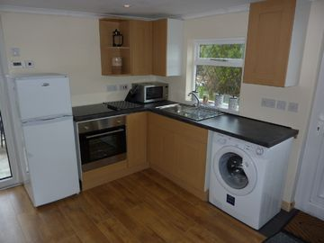 Lovely open plan kitchen with washing machine