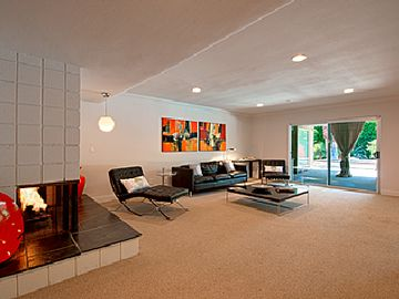Mid century Magic in your living room with gas fireplace.