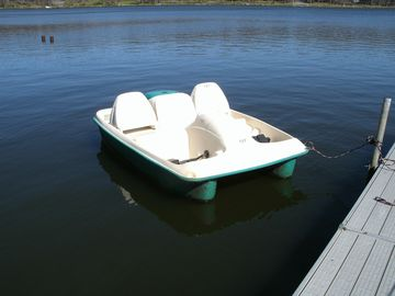 Paddle boat at the dock, ready for you to use, all summer for free!