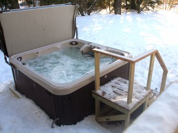 Brand new large 8 person hot tub off the back deck, with heated walkway.