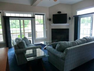 lake views from living room with high definition television and gas fireplace - Alton Bay condo vacation rental photo