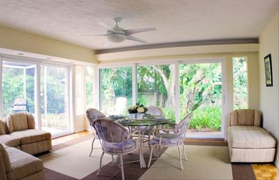 Dine indoors with fresh air & garden view w/ 2 walls of sliding glass doors