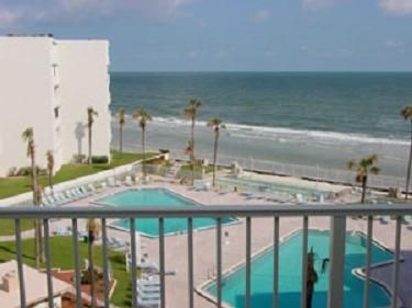 Your patio view of our 2 pools & nice ocean breeze on peaceful & quiet 5th floor