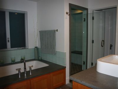 Master bathroom - tub with spa jets, large glass shower