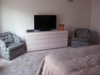 Seaside Heights condo photo - King master suite sitting area with flat screen TV. On suite bathroom.