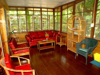 Negril cottage photo - spacious & bright living area in cottage