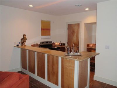 View of large bar in basement entertainment area