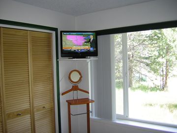 "Master bedroom 23"" LCD TV. Get your ski report as you awake!"