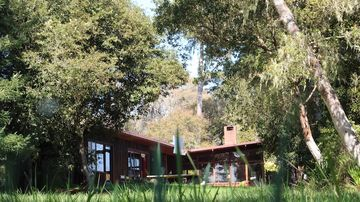Meadow, ocean and forest surround the Whitney House.
