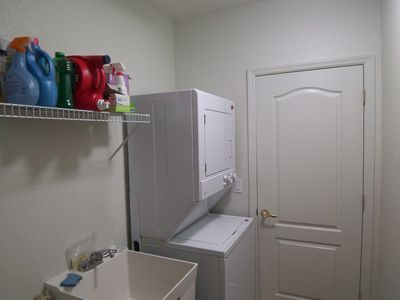 Stackable Washer and Dryer with Utility Sink.