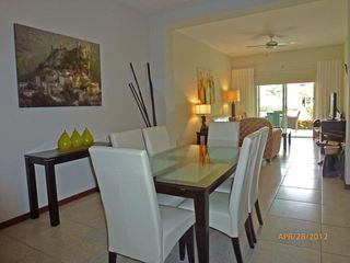 Nuevo Vallarta condo photo - Dining area sits 6 with white leather chairs.