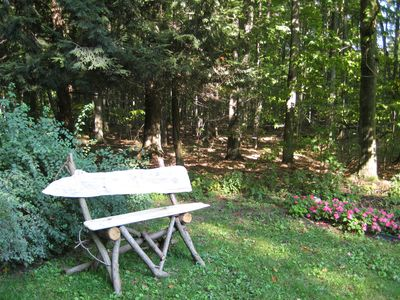 Glen Arbor house rental - Sit on one of our homemade rustic benches and enjoy the gardens