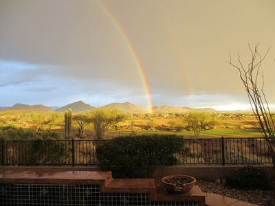 Arizona sunshower with double rainbow