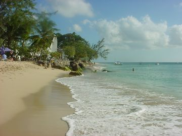 Holetown apartment rental - Three minute walk to the Caribbean Sea; low tide on the coral sandy beach.