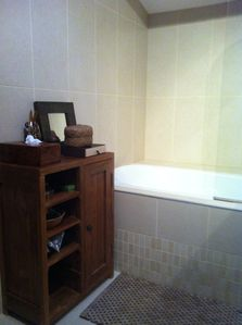 Bathroom view 2 - Bath and bespoke teak dresser