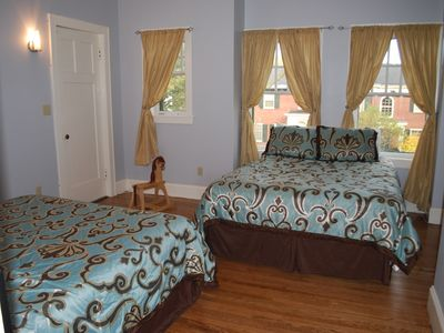 This bedroom has a screened porch off of it and features 2 queen beds