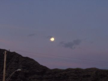 Full moon rising over the mountains