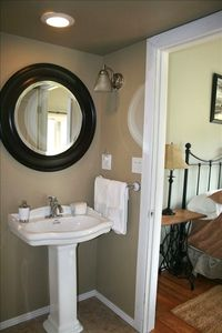 The master bathroom has a pedestal sink and bathtub/shower.